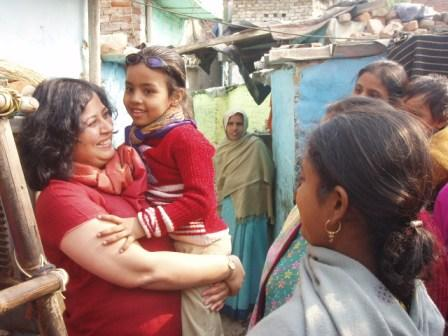 Dr Kiran with a slum child