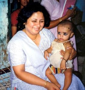 With a small child in the slum